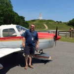 Dan Benedix became AERO'Connor Flight Training's first student pilot of 2015 to pass his private pilot check on January 05. He is pictured here with his PA28 on a Memorial-Day weekend visit to the First Flight Airport and Wright Brothers Memorial in Kill Devil Hills, NC. Dan is currently working on his instrument rating.